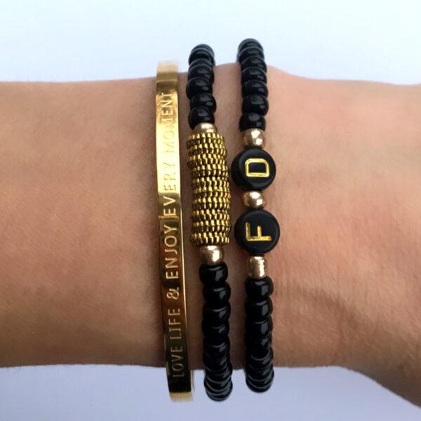 Armbanden zwart goud initial
