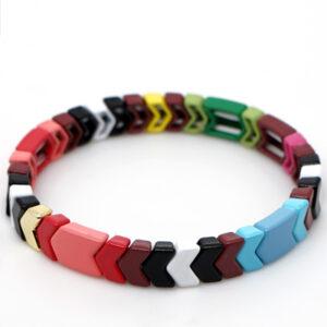 Gekleurde armbanden platte kralen warm colors