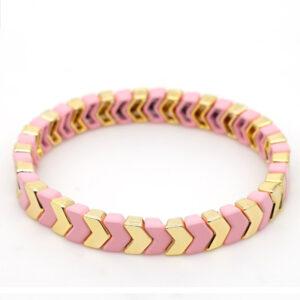 Gekleurde armbanden platte kralen pink