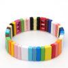 Gekleurde armbanden platte kralen breed multi color