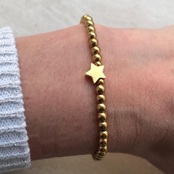 Gouden rvs armband met 1 ster